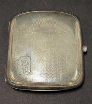 A George VI silver engine turned cigarette case with engraved monogram, maker D & F, Birmingham