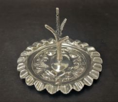 A George V silver ring tree with embossed shield decoration and wavy rim, maker James Dixon & Son,