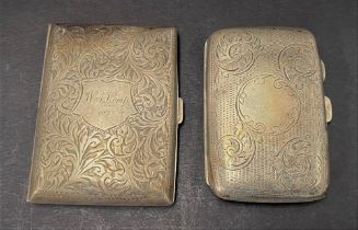 An Edwardian silver hallmarked cigarette case with engraved decoration, together with a George V