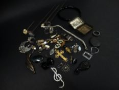 A quantity of costume jewellery including a silver tennis bracelet, silver soda fountain charm, a