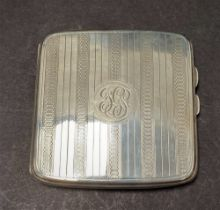 A George V silver engine turned cigarette case, width 8.5cm, Birmingham 1923, weight 3.50oz approx.