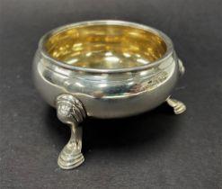 A George II silver salt raised on three outswept feet, indistinct maker DA?, London 1745, diameter