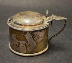 A Victorian silver hinge lidded mustard pot with blue glass liner, maker W.W., Birmingham 1901,