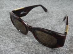 Gianni Versace, a pair of ladies sunglasses, Model MOD420/C COL900, marked 'MADE IN ITALY'.