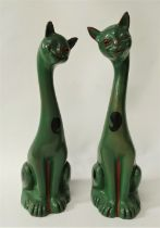 A pair of Aller Vale Torquay earthenware stylised models of cats with a glass winking eye with