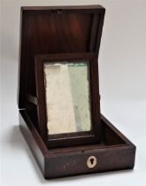 A George III mahogany boxwood and ebony banded campaign mirror within hinge lidded box, revealing an