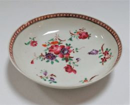 A 18th/19th century enamel decorated porcelain saucer dish by Newhall, diameter 12cm (chip to rim).