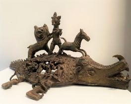 A Benin bronze group depicting a stylised lion figure and horse upon a mythical crocodile style