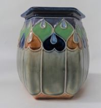 A Royal Doulton hexagonal section stoneware vase No.7763, with tubelined decoration, height 14cm.