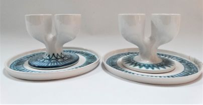 A pair of early Troika St Ives pottery double eggcups upon stands with underglaze blue zig zag