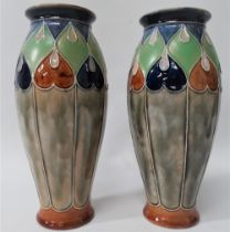 A pair of Royal Doulton stoneware vases with tubelined decoration, No.7760E, height 24cm.