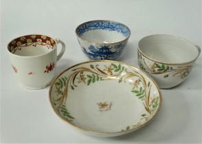 A 19th century porcelain teacup and saucer, foliate enamel scroll painted with gilt highlights,