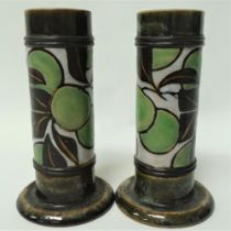 A pair of Royal Doulton stoneware cylindrical vases with a spread foot, with a band of incised