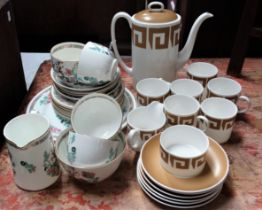 A Susie Cooper coffee set in 'Keystone' pattern, Old Gold C2134, comprising a coffee pot, milk