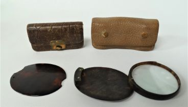 A pair of mother of pearl opera glasses within faux leather carry case, width of glasses 8.5cm,