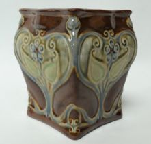 A Royal Doulton stoneware square section jardiniere, each side with stylised foliate relief modelled
