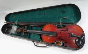 A Stradivarius copy violin with 13.25inch back, the button stamped J.T.L, with nickel mounted bow