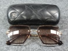 Chanel, a pair of ladies sunglasses, A??00 51 17-139 C2, marked 'MADE IN ITALY', left lens marked