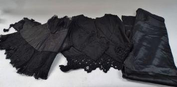 A Victorian lilac silk skirt, length 92cm, a Victorian black cotton and silk stitch cape, a ladies
