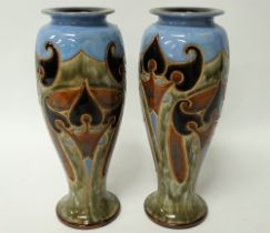 A pair of Royal Doulton stoneware tall baluster vases with incised stylised foliate decoration,