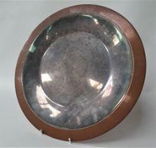 A Georg Jensen design copper and silvered dish, stamped 'GEORG JENSEN DESIGN', diameter 35cm.