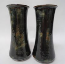 A pair of Royal Doulton stoneware cylindrical vases with dark green mottled ground No.7733D,