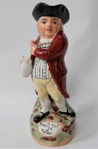 A 19th century Staffordshire Walton style 'Hearty Goodfellow' toby jug, height 28cm.