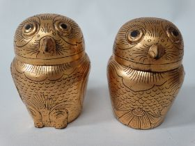 A pair of gilt painted black lacquer papier mache owl modelled boxes, height 10cm.