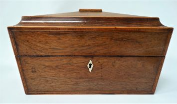 A good Georgian rosewood boxwood inlaid sarcophagus form tea caddy, the hinge lid revealing a fitted