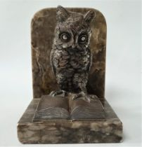 A silvered spelter owl and book modelled bookend upon an alabaster stand, height overall 14cm.
