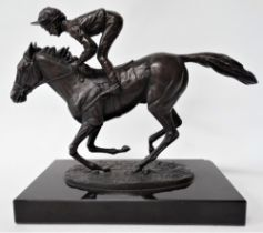 A modern bronze group upon black marble stand after David Cornell 'Champion Finish' depicting Lester