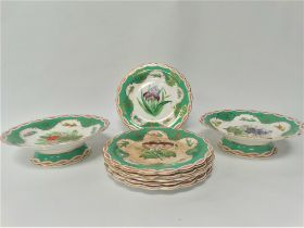 A 19th century porcelain part dessert set, comprising two comports and six plates, each with