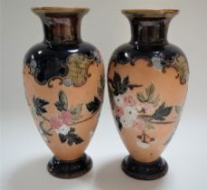 A pair of Doulton Lambeth Slaters Patent vases, tubeline decorated with blossoming branches upon a
