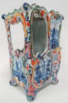 A Delft polychrome decorated model of a sedan chair, monogram to the base, height including lid 21cm