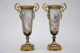 A pair of vases in Sèvres porcelain 'galant couple' (35cm) (*)