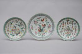 Three dishes in Chinese porcelain 'antiquities' (29 - 34cm)