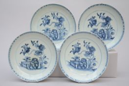 Four dishes in Chinese blue and white porcelain 'pomegranates', 18th century (dia 28 cm) (*)