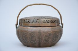 A Chinese bronze hand warmer (12x21x16 cm)