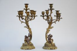 Pair of Louis XV style candlesticks in bronze 'putti' (h58cm)