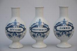 Three faience apothecary vases, 18th century (27 cm)