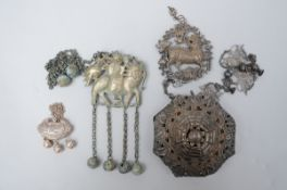 Lot: three Chinese silver pendants