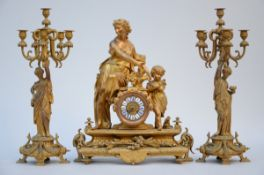 Mantlepiece in gilt pewter 'mother with child' (62x50x18cm) (h65cm) (65cm)