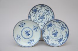 Three dishes in Chinese blue and white porcelain, 18th century (dia 28 cm)