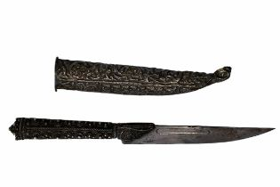 A 19th century filigree knife with scabbard. Foliage decoration, single edged blade with three stars