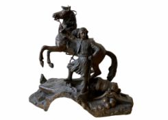 A spelter sculpture of a soldier, probably Greek or Turkish holding his horse. 23 cm (H) x 23 cm (W)
