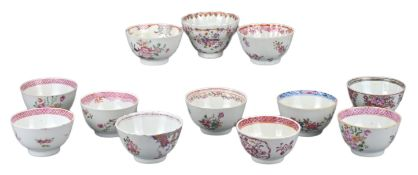 TWELVE CHINESE FAMILLE ROSE PORCELAIN TEACUPS, 18th CENTURY