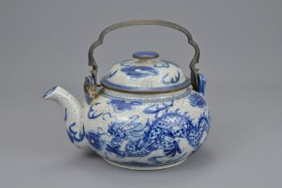 A CHINESE PORCELAIN BLUE AND WHITE TEAPOT