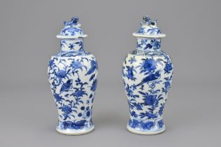 TWO CHINESE BLUE AND WHITE PORCELAIN VASES WITH COVERS
