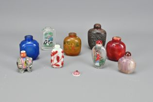 Nine Vintage Chinese Snuff Bottles In Varying Mate