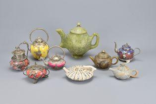 Nine Oriental Teapots